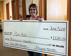 Pam Hole, manager of financial services, wins $1,020 with MHC's Project 50/50 draw.
