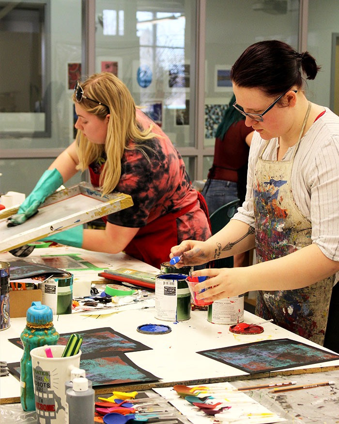Visual communications students work in the print making lab at MHC.
